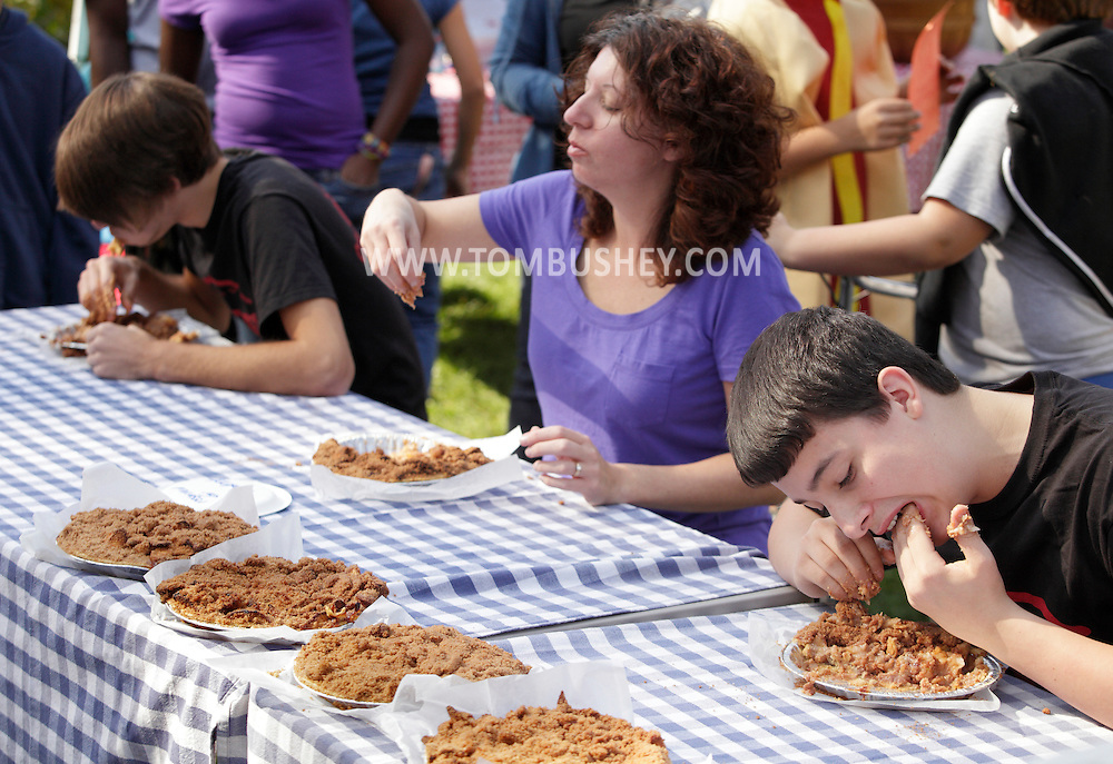 New Hampton, New York - People compete in a pie-eating contest during the celebration of 100 years in business at Soons Orchards and Farm Market  on Oct. 11, 2010. ©Tom Bushey / The Image Works