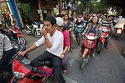 Old Town. Motorbikes during evening rushhour.