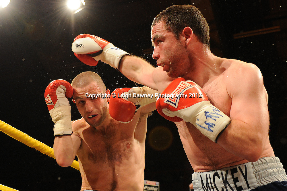 Martin Lindsay (silver shorts) defeats Mickey Coveney in a 6x3 Featherweight contest at Kings Hall, Belfast, Northern Ireland on Saturday 5th May 2012. Promoted by Prizefighter/Matchroom Sport. © Leigh Dawney Photography 2012.