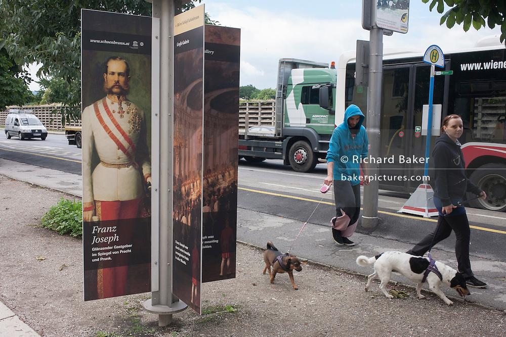 Austrian Emperor Franz Josef and modern day dog walkers outside Schloss Schonbrunn, in Vienna, Austria, EU.