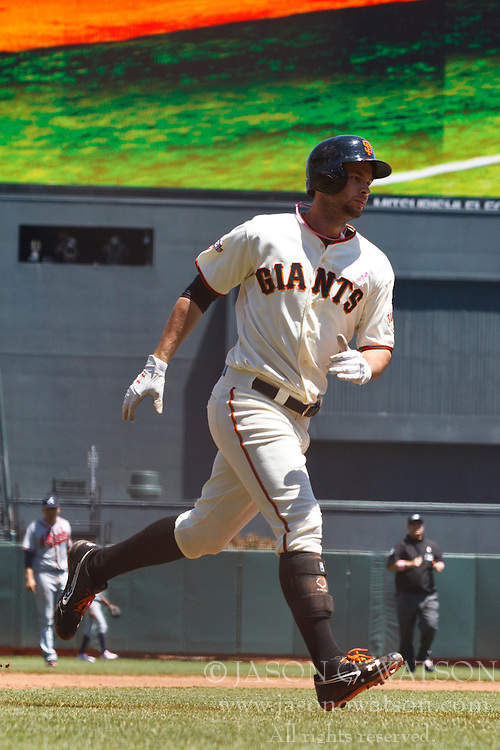 SAN FRANCISCO, CA - MAY 12: Brandon Belt #9 of the San Francisco Giants rounds the bases after hitting a home run against the Atlanta Braves during the second inning at AT&T Park on May 12, 2013 in San Francisco, California. The San Francisco Giants defeated the Atlanta Braves 5-1. (Photo by Jason O. Watson/Getty Images) *** Local Caption *** Brandon Belt
