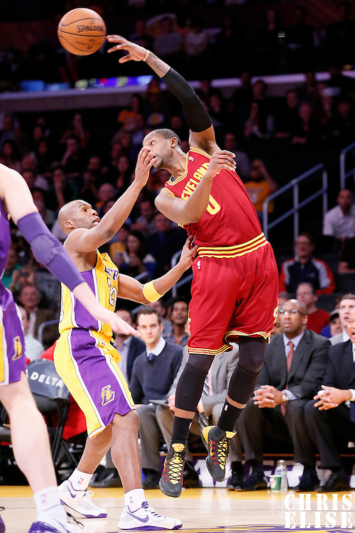 14 January 2014: Cleveland Cavaliers shooting guard C.J. Miles (0) passes the ball over Los Angeles Lakers shooting guard Jodie Meeks (20) during the Cleveland Cavaliers 120-118 victory over the Los Angeles Lakers at the Staples Center, Los Angeles, California, USA.