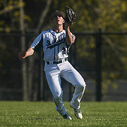 St. Marks Outfielder Austin Colmery (2) catches a fly ball in left field during a regular season baseball game between the St. Marks Spartans and Caravel Academy at St. Marks Stadium Thursday April 14, 2016 in Wilmington.