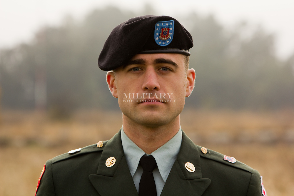 US Army sergeant in Class A uniform with beret and decorations.  Model released.  Image does not comply with USDOD regulations for advertising use without modification of insignia and decorations.