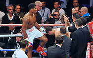 Picture by Alan Stanford/Focus Images Ltd +44 7915 056117<br />05/10/2013<br />Anthony Joshua holds the ropes for Emanuele Leo to exit the ring after his first round knockout in their Heavyweight Contest at the O2 Arena, London.
