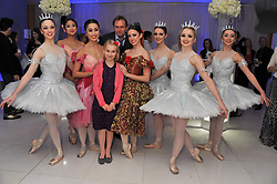 PHILIP GLENISTER and his daughter MILLIE and ENB dancers at the pre party for the English National Ballet's Christmas performance of The Nutcracker held at the St.Martin's Lane Hotel, St.Martin's Lane, London on 14th December 2011.