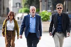 © London News Pictures. 19/06/2016. London, UK. Leader of the Labour Party JEREMY CORBYN (centre) arrives at BBC Broadcasting House in London with his wife LAURA ALVAREZ (left) and Director of Strategy SEUMAS MILNE (right) to appear on the Andrew Marr Show. Photo credit: Ben Cawthra/LNP