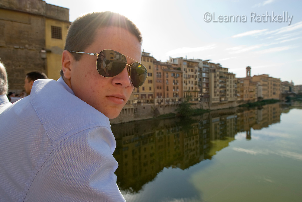 Teenager relaxes on the Ponte Vecchio bridge, Florence, Italy.
