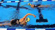 Swimmers form Bull City Aquatics in Durham, N.C. do warm-up laps during the early afternoon, preparing for competition in the Long-Course Open Friday at the Trousdell Aquatic Center in Tallahassee. The event lasts through Sunday.