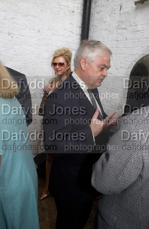 Sam Wylie-Harris and Norman Lamont. Spectator party. Doughty St. London. 28 July 2005. ONE TIME USE ONLY - DO NOT ARCHIVE  © Copyright Photograph by Dafydd Jones 66 Stockwell Park Rd. London SW9 0DA Tel 020 7733 0108 www.dafjones.com