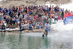 """""""Cushing Classic at Squaw Valley 1"""" - Photograph of a skier crossing a pond during the Cushing Classic at Squaw Valley, USA."""