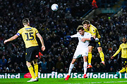 Millwall defender Shaun Hutchinson (4) and Leeds United forward Patrick Bamford (9) in action during the EFL Sky Bet Championship match between Leeds United and Millwall at Elland Road, Leeds, England on 28 January 2020.