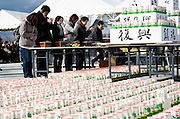 Residents pray in front of an alter during a ceremony to mark the one year anniversary of last year's magnitude 9 earthquake and tsunamis during a remembrance service in Ofunato City, Iwate Prefecture, Japan on 11 Mar. 2012. .Photographer: Robert Gilhooly
