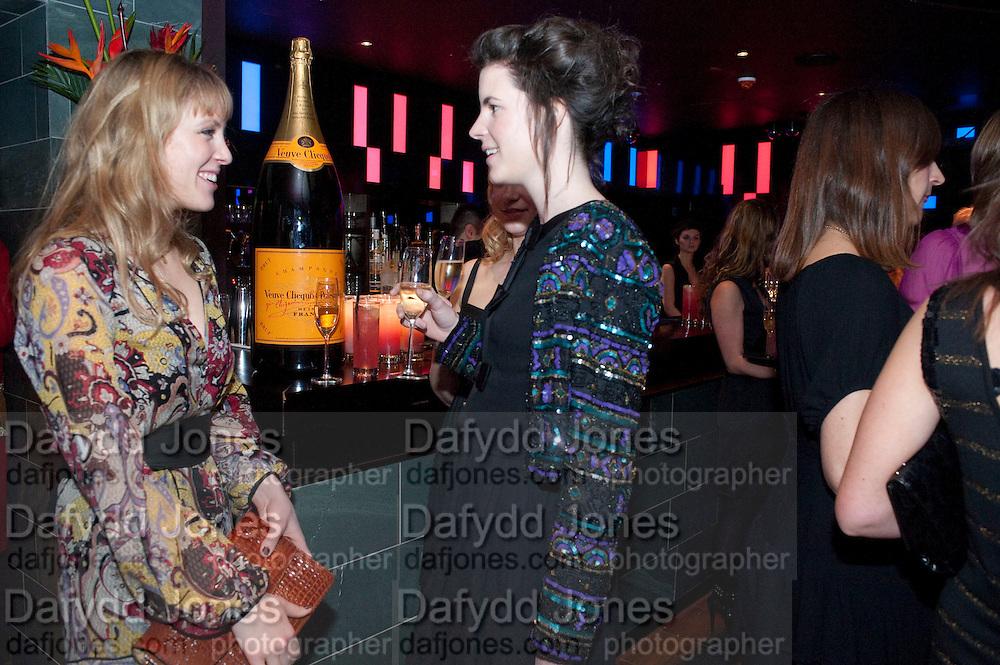 EMMA WIGAN; LADY LAURA CATHCART; The Tatler Little Black Book party. Chinawhite club. London. 21 November 2009