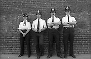 Police stand on Portobello Road during Notting Hill Carnival, 1990