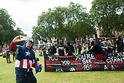 Man dressed as Captain America takes selfie in front of Anti Fascists, London, 2010s