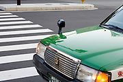 Japanese taxi crosses a zebra crossing Tokyo Japan