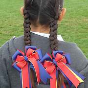 Little rider after the leadline class at a horse show. The pigtails are always a favorite part