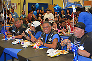 Members of the Thin Blue Line Foundation and Law Enforcement Motorcycle Club enjoy lunch provided by Stevens ES.