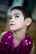 """Bangkok November 13, 2013<br /> Kafille is 6 years old. His mother had noticed since he was 3 years old, he already behaved as a little girl, showing signs of being feminine. His older brother, Aekachai, 23, is a ladyboy, and Kafille was definitely influenced by him.As her mother said: """"we can't do anything, he has to follow his heart and has to live his life the way he wants to""""Bangkok 13 novembre 2013<br /> Kafille a 6 ans. Sa mère l'avait remarqué dès l'âge de 3 ans, il se comportait déjà comme une petite fille, montrant des signes de féminité. Son frère aîné, Aekachai, 23 ans, est une coccinelle, et Kafille a été définitivement influencé par lui, comme l'a dit sa mère : """"On ne peut rien faire, il doit suivre son coeur et vivre sa vie comme il le veut"""""""