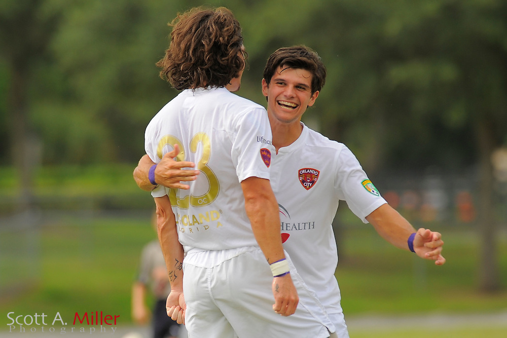Orlando City forward Drew Helm (23) celebrates his game-tying goal with Orlando City midfielder Orlando City midfielder Anthony Arico (19) during City's 4-2 win over the Austin Aztex in PDL Southern Conference Championships final at Trinity Catholic High Schooll on July 22, 2012 in Ocala, Florida. ..©2012 Scott A. Miller
