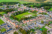Nederland, Overijssel, Sint Jansklooster, 10-10-2014; dorp vernoemd naar het gelijknamige klooster, vernietigd tijden de Tachtigjarige Oorlog. Na-oorlogse nieuwbouw rond centraal grasveld.<br /> Village named after the monastery, destroyed during the uprising against the Spanish (17th century).<br /> luchtfoto (toeslag op standard tarieven);<br /> aerial photo (additional fee required);<br /> copyright foto/photo Siebe Swart