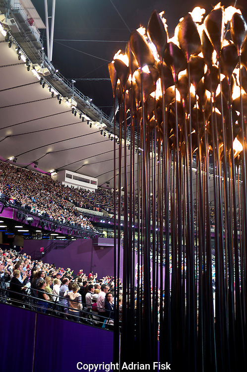 The Olympic flame burns in the stadium.