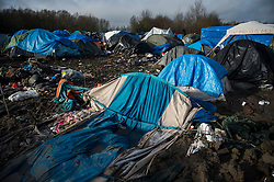 © Licensed to London News Pictures. 23/01/2016. Dunkirk, France. A collapsed tent in the Dunkirk camp on the day that Leader of the Labour Party JEREMY CORBYN visited a temporary camp in Dunkirk, France, where thousands of migrants and refugees attempting to reach the UK are currently living. Photo credit: Ben Cawthra/LNP
