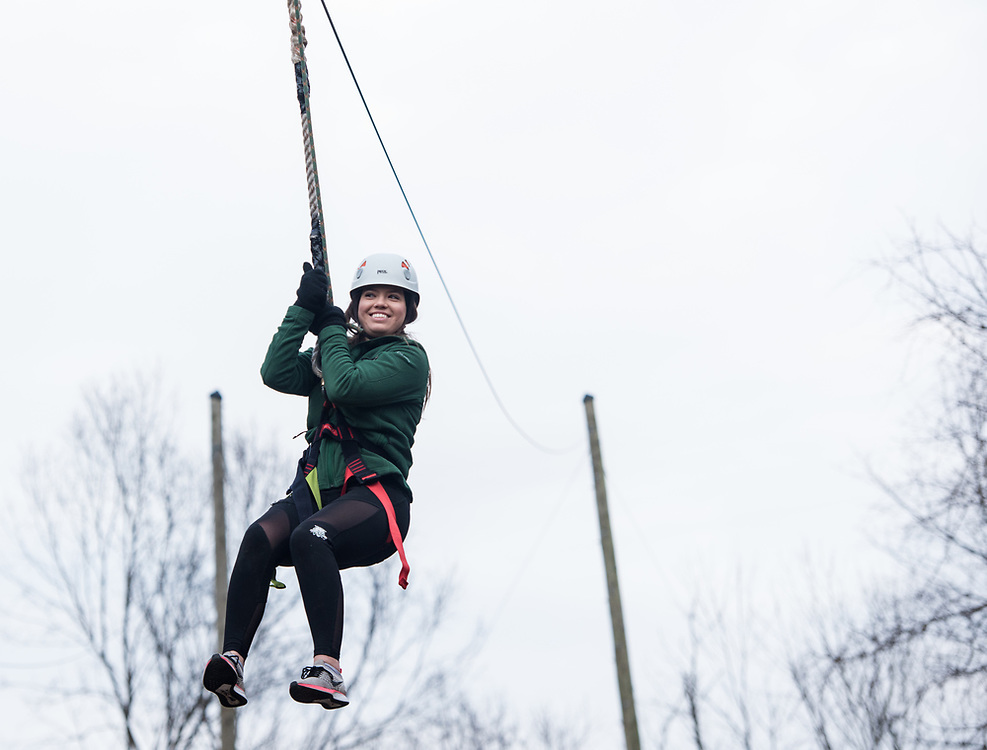 Maddie Grabill zip lines as the Zip Line facility Sibs Weekend event at The Ridges on Feb. 3rd, 2018.