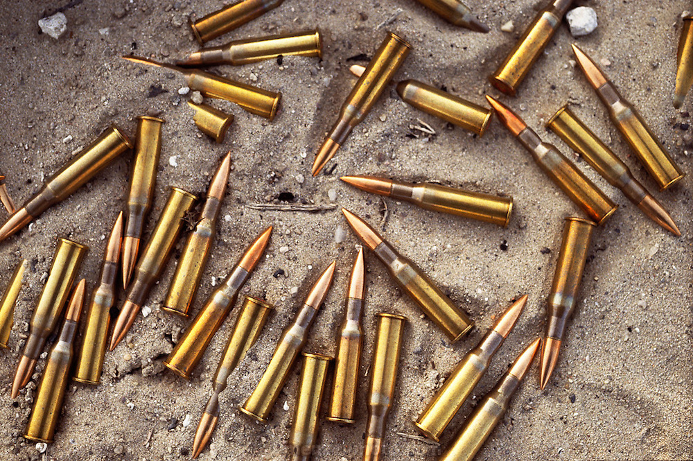 "Abandoned bullets in the sand by the Jahra Road from Kuwait City to Basra, Iraq. American forces chased and trapped retreating Iraqi forces north of Kuwait City on the night of February 25 and the day of February 26, 1991. These units withdrew via the Jahra road on the way to Basra, an escape route that has become known as the ""highway to hell."" They were attacked by coalition aircraft and it is estimated that several thousand retreating Iraqis died.."