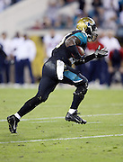 Jacksonville Jaguars outside linebacker Geno Hayes (55) intercepts a late fourth quarter pass that clinches the win during the NFL week 14 football game against the Houston Texans on Thursday, Dec. 5, 2013 in Jacksonville, Fla. The Jaguars won the game 27-20. ©Paul Anthony Spinelli