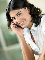 Woman Using Cell Phone indoors portrait