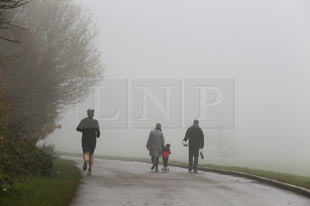 © Licensed to London News Pictures. 24/11/2019. London, UK. Park users in thick fog in Alexander Palace park, north London on a freezing morning. Photo credit: Dinendra Haria/LNP