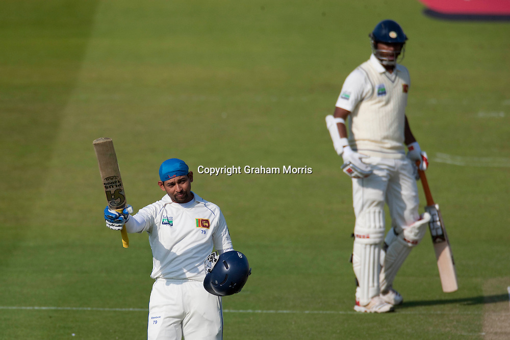 Tillakaratne Dilshan celebrates his century (and later a 207 partnership with Tharanga Paranavitana, right) during the second npower Test Match between England and Sri Lanka at Lord's.  Photo: Graham Morris (Tel: +44(0)20 8969 4192 Email: sales@cricketpix.com) 04/06/11