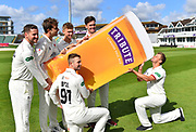 Tim Rouse of Somerset pretending to drink a large pint of Tribute Cornish Pale Ale held up by five of his team mates during the 2019 media day at Somerset County Cricket Club at the Cooper Associates County Ground, Taunton, United Kingdom on 2 April 2019.