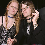 Goth couple wearing spike neck bands, Cardiff, UK 2000's
