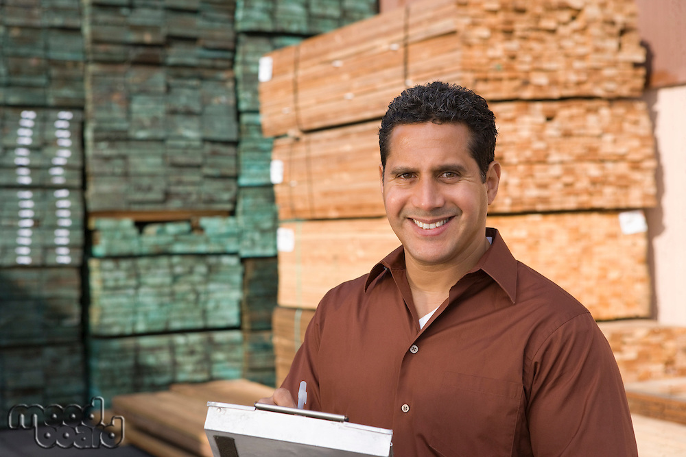 Mid-adult man stock-taking in warehouse