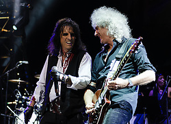 "© Licensed to London News Pictures. 16/09/2012. London, UK.  Alice Cooper (Centre) and Brian May (Right) performs at The Sunflower Jam at the Royal Albert Hall.  The Sunflower Jam is a British charity, founded by Jacky Paice, wife of Deep Purple drummer, Ian Paice. Other high-profile supporters are the actor Jeremy Irons, ex-Jamiroquai bassist Nick Fyffe and Charles, Prince of Wales. The aims of the charity are to fund complementary therapists and spiritual healers to work on cancer wards in the British National Health Service. After setting up a meeting between members of Deep Purple and a young boy dying of leukemia, Paice saw ""all the good work the healers were doing"" and decided ""lets find a way to raise money to get more healers in there. Photo credit : Richard Isaac/LNP"