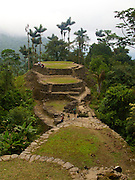 "Tourists and military officials enjoy the ruins of the ""Lost City"" in the in Sierra Nevada - Ciudad Perdida - Colombia"