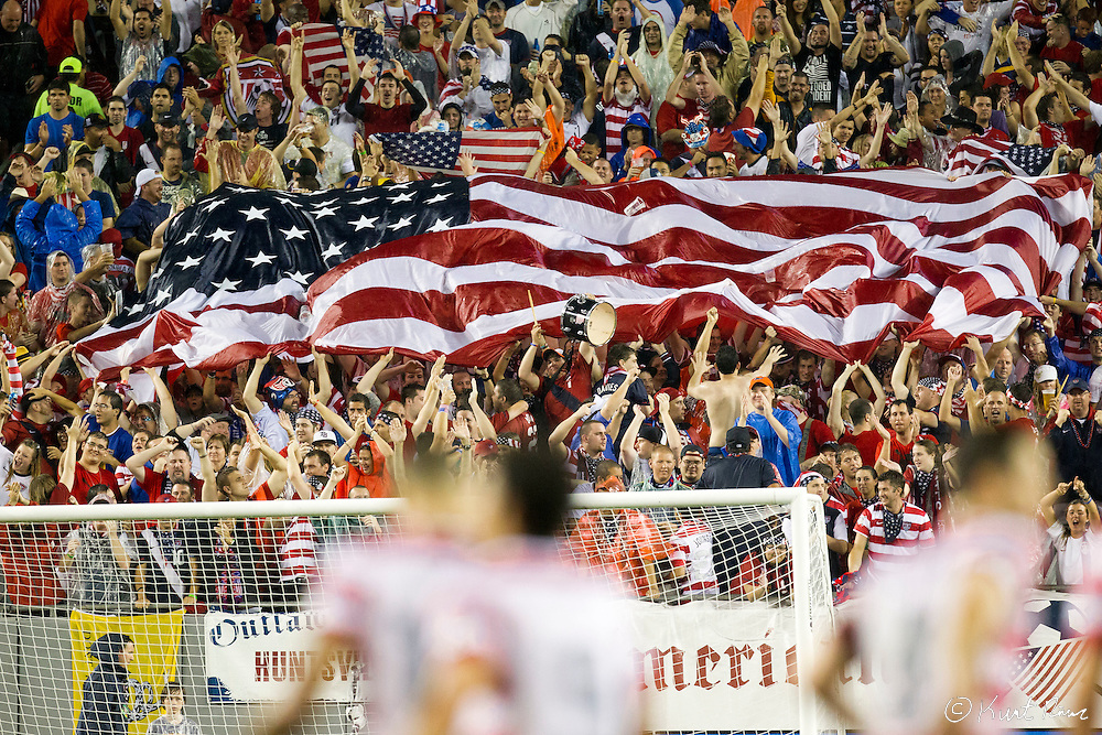 Fans wave a large American flag during the Antigua & Barbuda vs USA Men's National Team  semifinal round of 2014 FIFA World Cup qualifier at Raymond James Stadium in Tampa, Fl. .