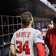 Bryce Harper, (left), Washington Nationals, in the dugout with Matt Williams, Washington Nationals Manager, during the New York Mets Vs Washington Nationals MLB regular season baseball game at Citi Field, Queens, New York. USA. 31st July 2015. Photo Tim Clayton