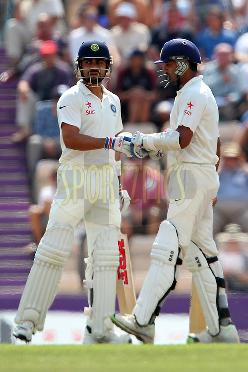 Virat Kohli of India ad Murali Vijay of India during day three of the third Investec Test Match between England and India held at The Ageas Bowl cricket ground in Southampton, England on the 29th July 2014<br /> <br /> Photo by Ron Gaunt / SPORTZPICS/ BCCI