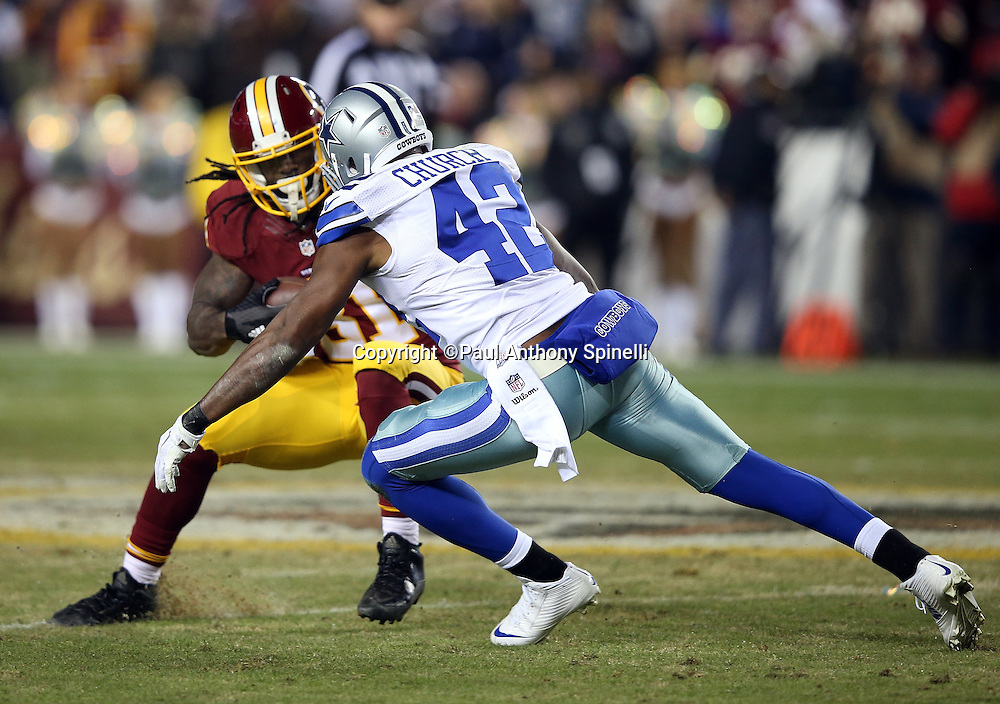 Washington Redskins running back Matt Jones (31) tries to elude a tackle attempt by Dallas Cowboys strong safety Barry Church (42) as he runs with the ball after catching a second quarter pass for a gain of 5 yards during the 2015 week 13 regular season NFL football game against the Dallas Cowboys on Monday, Dec. 7, 2015 in Landover, Md. The Cowboys won the game 19-16. (©Paul Anthony Spinelli)