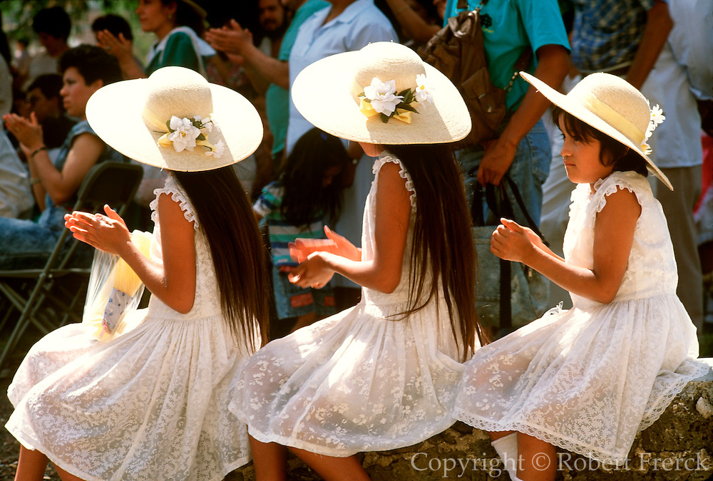 MEXICO, PORTRAITS three young girls with hats at village event in Tepoztl�n near Cuernavaca