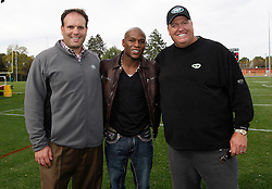 "October 8, 2009; Florham Park, NJ; USA; Floyd ""Money"" Mayweather (c) poses with NY Jets GM Mike Tannenbaum (l) and head coach Rex Ryan (r) at New York Jets camp in Florham Park, NJ."