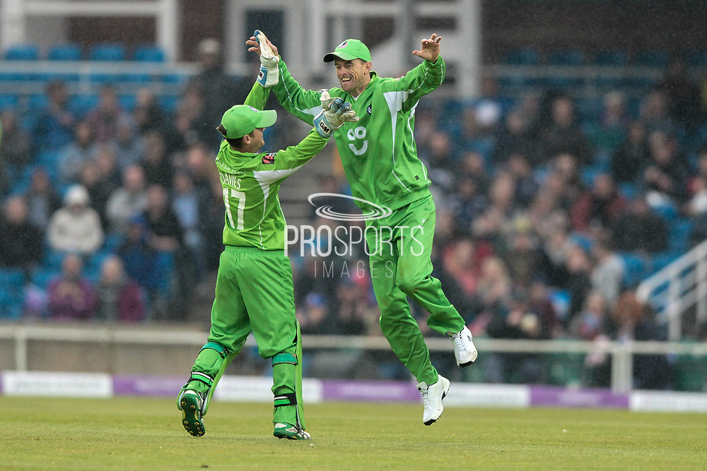 Joe Root (Yorkshire Vikings) edges the ball in the dark and drizzle to D Villas (Lancashire Lightning) who celebrates taking the England captain's wicket for 21 runs during the Royal London 1 Day Cup match between Yorkshire County Cricket Club and Lancashire County Cricket Club at Headingley Stadium, Headingley, United Kingdom on 1 May 2017. Photo by Mark P Doherty.