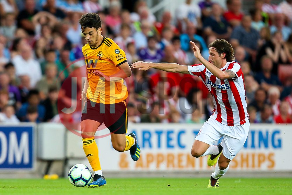 Ryan Gills of Wolverhampton Wanderers takes on Joe Allen of Stoke City - Mandatory by-line: Robbie Stephenson/JMP - 25/07/2018 - FOOTBALL - Bet365 Stadium - Stoke-on-Trent, England - Stoke City v Wolverhampton Wanderers - Pre-season friendly