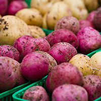 Red and white skin potatoes at a farmers market.