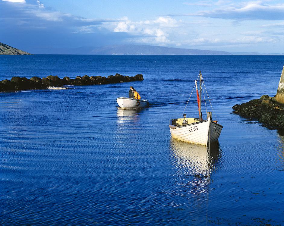 Fishermen return home to Cushendun on the Antrim Coast, Northern Ireland.