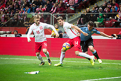 November 10, 2017 - Warsaw, Poland - Jakub Blaszczykowski (16), Bartosz Bereszynsk (14) and Cristian Rodriguez (7) during the international friendly soccer match between Poland and Uruguay at the PGE National Stadium in Warsaw, Poland on 10 November 2017  (Credit Image: © Mateusz Wlodarczyk/NurPhoto via ZUMA Press)